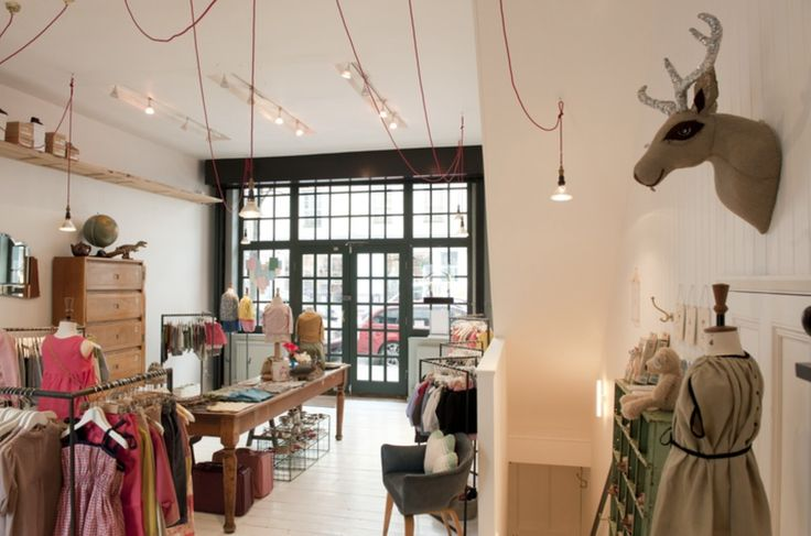 Whimsical interior of Caramel Baby and Child because why shouldn't children's clothes be beautiful and tough-wearing at the same time? Refined simplicity, distinctive and occasionally quirky. On Ledbury Road opposite Matches Fashion.