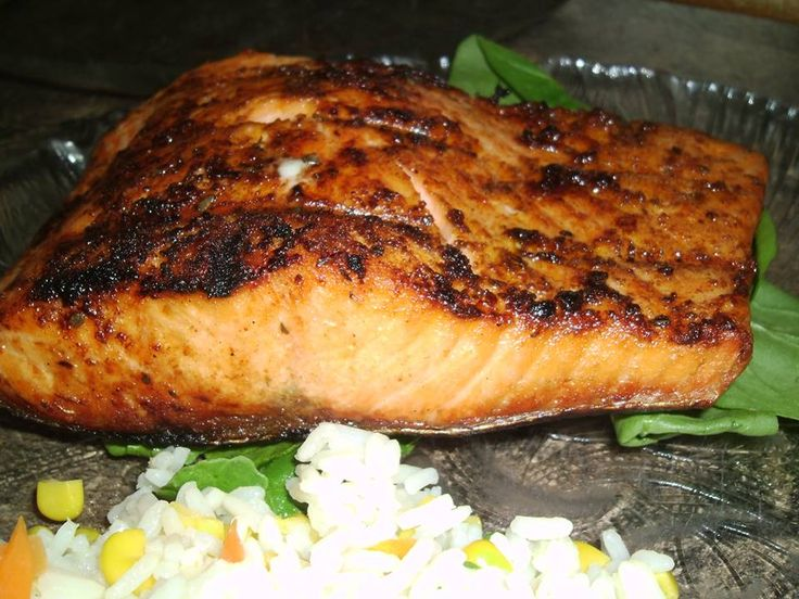 1 T. Paprika 2 1/2 tsp. salt 1 tsp. onion powder 1 tsp. garlic powder 3/4 tsp. cayenne pepper 3/4 tsp. black pepper 1/2 tsp oregano  2 - 5oz. salmon filets (fresh or frozen) 2 T. melted butter  medium high heat. Brush both sides of salmon with butter and then (with tossed seasoning) coat both sides of the fish. Place flesh side down on grill for 8 minutes, then carefully turning over to skin side for an additional 5 minutes.
