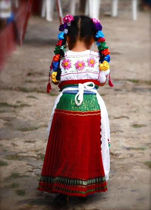 A little girl in her traditional costume