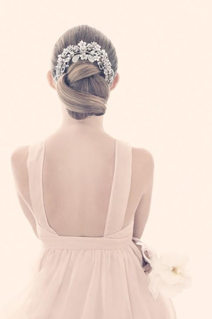 Stunning wedding hair updo with accessory.