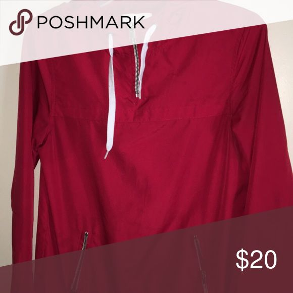 Red wind breaker This is a red wind breaker with a zipper pocket, Great condition Sweaters