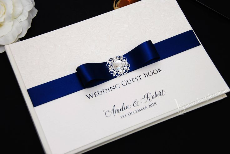 Wedding Guest Book - Personalised, hardcover with flourish embossed paper, navy ribbon and a Victorian brooch by InvitedinStyle on Etsy