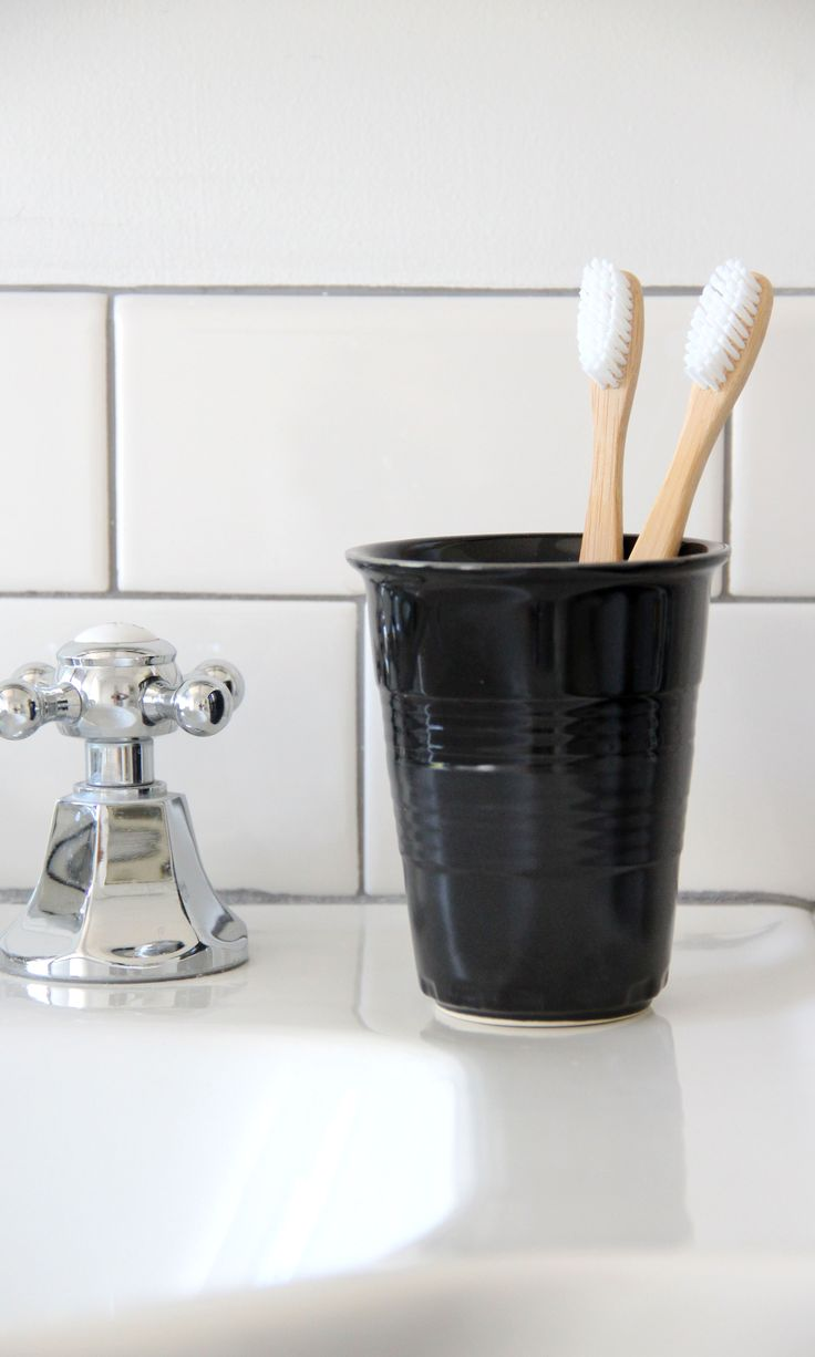 Modern toothbrush holder in ceramic black (via Simplified Bee)