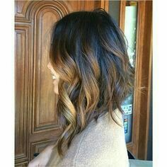 Drastic inverted Bob. Long hair. Curls and hombre