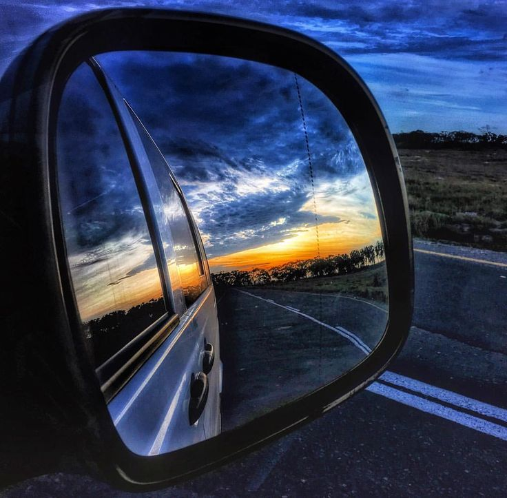 Photo by @manablazemick • side mirror shot · rear view · looking back · mountains · road trip · travel · black and white · South Africa · sunset · rural · photography · traffic · transport · landscapes · sky · clouds