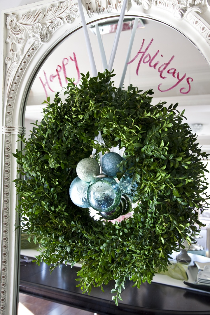 wreath on mirror with merry christmas