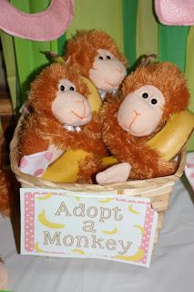 adopt a monkey, monkey theme birthday dollar tree basket and monkeys  and real bananas :)