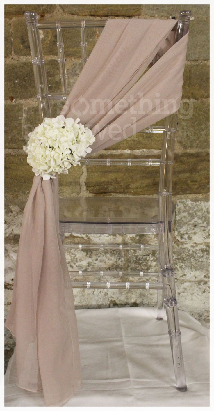 An elegant blush chiffon chair tie, adorned with ivory hydrangeas.