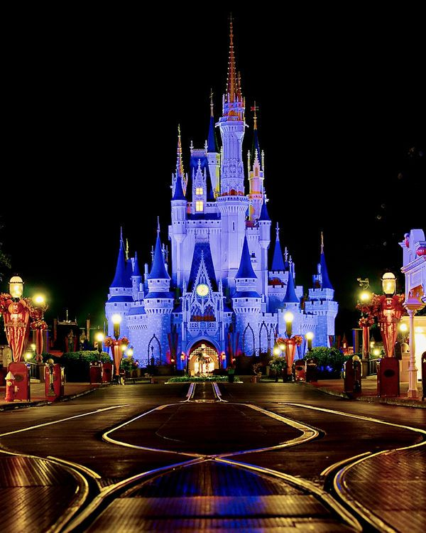 an empty main street at night explored l How to Plan a Disney Vacation Without Breaking the Bank