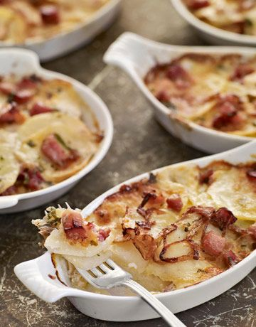 Prepare a whole new dish using leftover ham with this easy potato, cheese, and ham casserole recipe. Dividing the gratin between ramekins makes for perfect individual main course servings. Recipe: Ham and Potato Gratins - CountryLiving.com