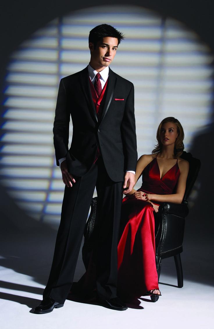 Black shirt red tie vest