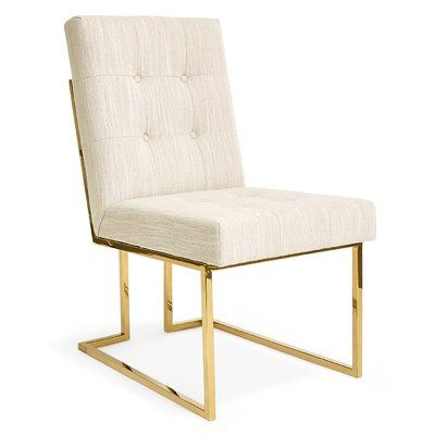 This side chair exhibits elegance upholstered in silky-smooth white leatherette with nail head silver trim accents on the edges. This contemporary side chair is framed in X-shaped rose gold steel.