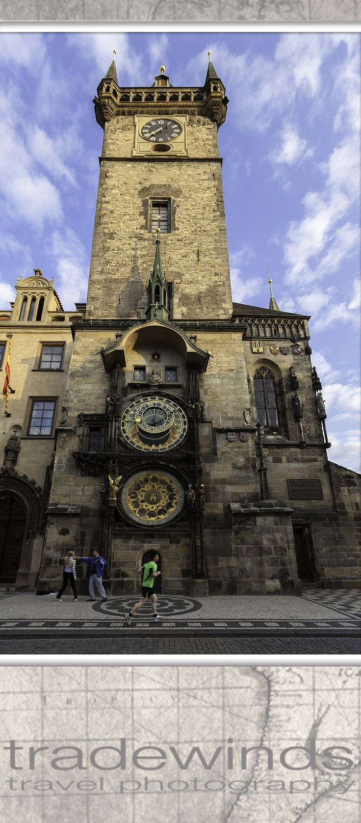 A couple dances in front of the old famous clock tower in Prague