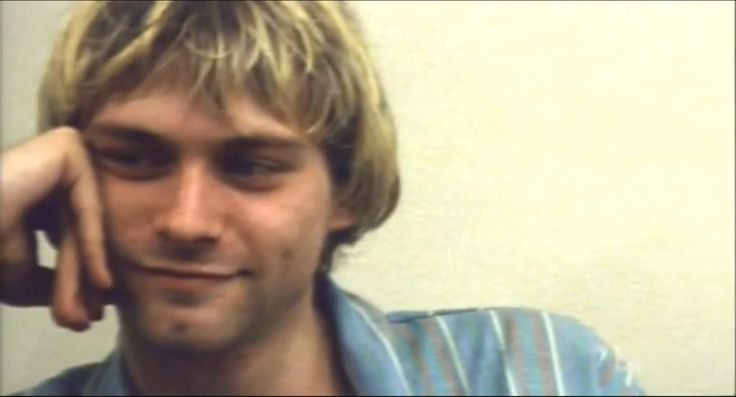 Kurt Cobain with short hair. ( cute, but I prefer him with longer hair!!)