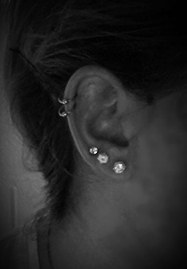 Double cartilage piercing, triple ear lobe piercing.