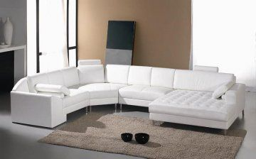 Monaco White Leather Sectional Sofa at www.GoWFB.ca | The Monaco White Leather Sectional Sofa by True Contemporary is a great way to stretch out and relax in style after a long day. A unique extra-wide, tufted chaise is perfect for snuggling. The adjustable headrests make this white sofa extra comfortable while the stainless steel legs add a modern, sleek touch. Pillows are included. | Free Shipping #Canada