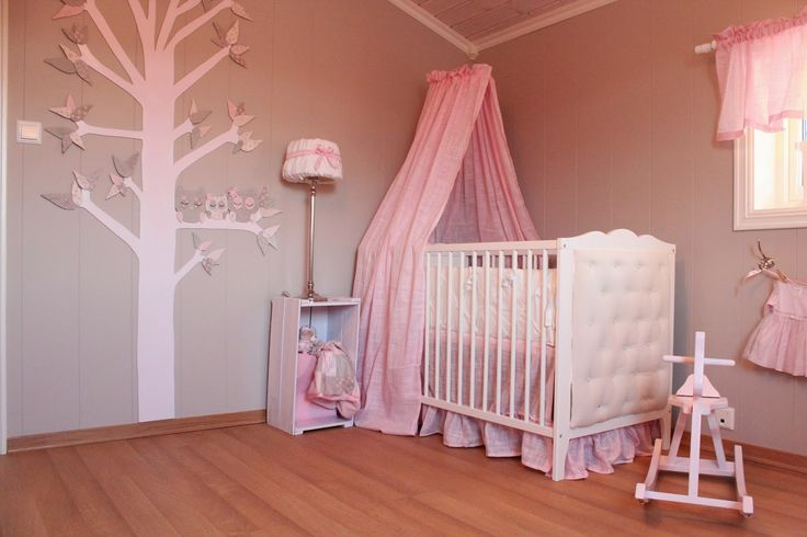 Nursery design ideas - DIY canopy over the crib, tree and own wall mural, repurposed and painted crate for side table; bed skirt.