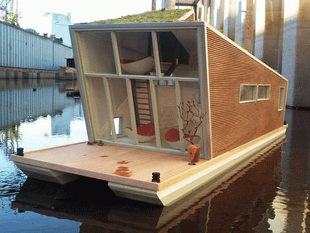 This prefab German houseboat rocks a living roof.   28 Houseboats That Will Make You Want To Float Away