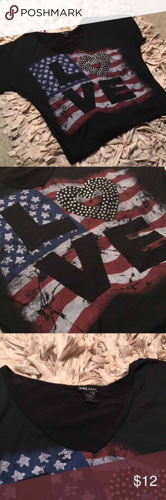 "🇺🇸 Black Vneck batwing tee with love graphic. XL Black Vneck tee with a bat wing. American flag graphic with ""love"" printed on top. The ""o"" is a heart with silver studs. Worn once! Nice flowy fit. Could be worn off the shoulder. XL Tops"