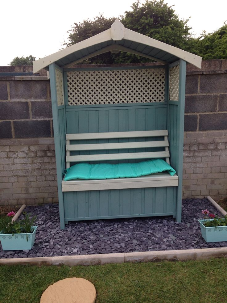 dorset garden arbour painted in cream and seagrass