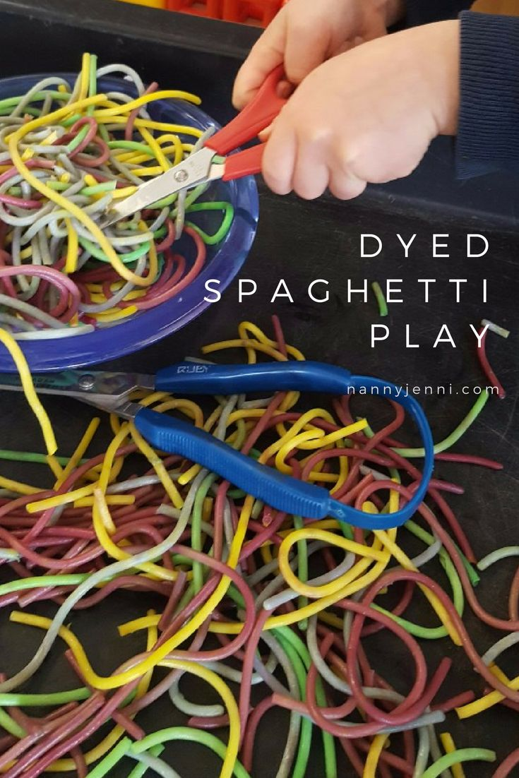 Come and take a look at this wonderful sensory activity for children! It's dyed spaghetti play with scissors to practise cutting.
