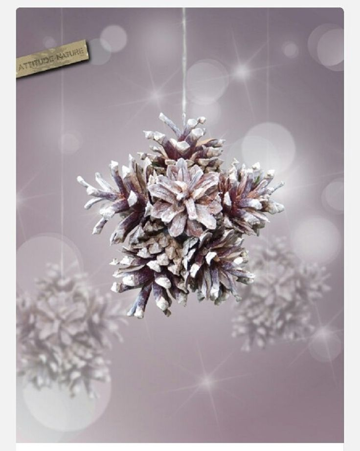 DIY Snowflake with Pinecones - 15 Beautiful DIY Snowflake Decorations for Winter | GleamItUp