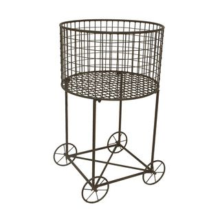 Whether ferrying loads of laundry to the washer or sitting in a corner, storing extra towels or pillows, our Vintage Wire Laundry Basket Hamper looks great. Made of iron with an oxidized finish, the v