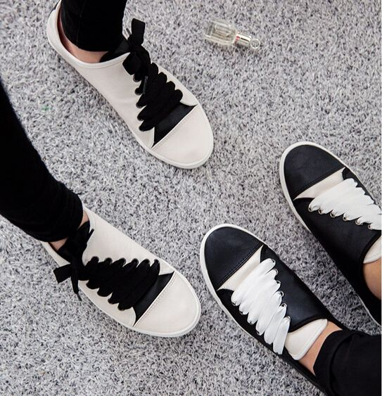 Contrast trainers from Ann Demeulemeester, with funky diagonal laces. Inspiration for our Monochrome Twist shoot in the June 16 issue.