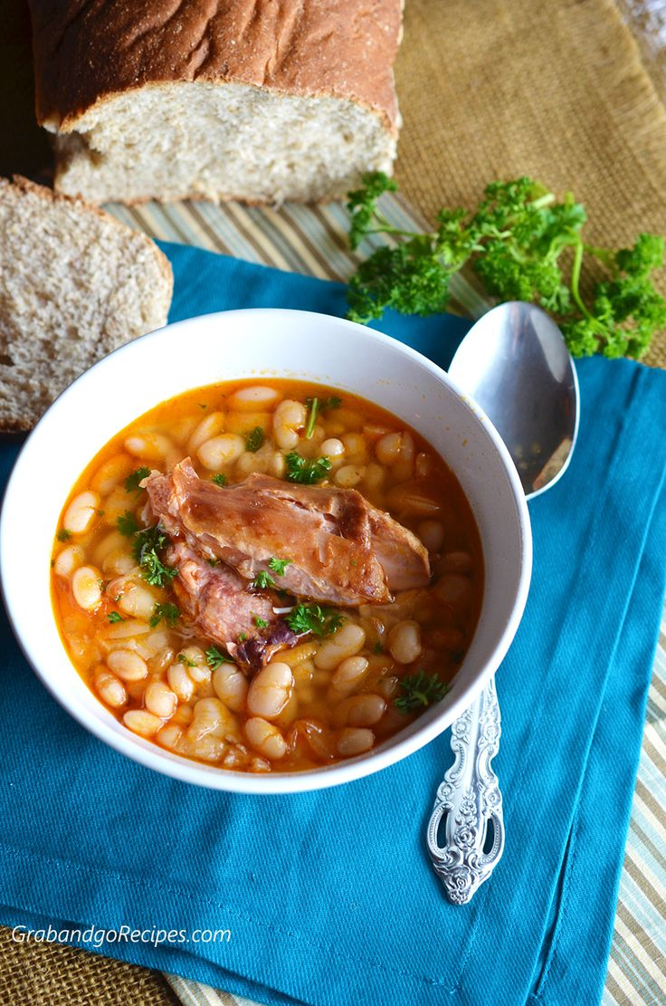 This Smoked Turkey White Bean Soup is made from scratch with dried beans, slowly simmered to tenderness with smoked turkey legs and warm spices. It is so delicious, hearty, filling and uses turkey instead of ham which really cuts the fat and calories.