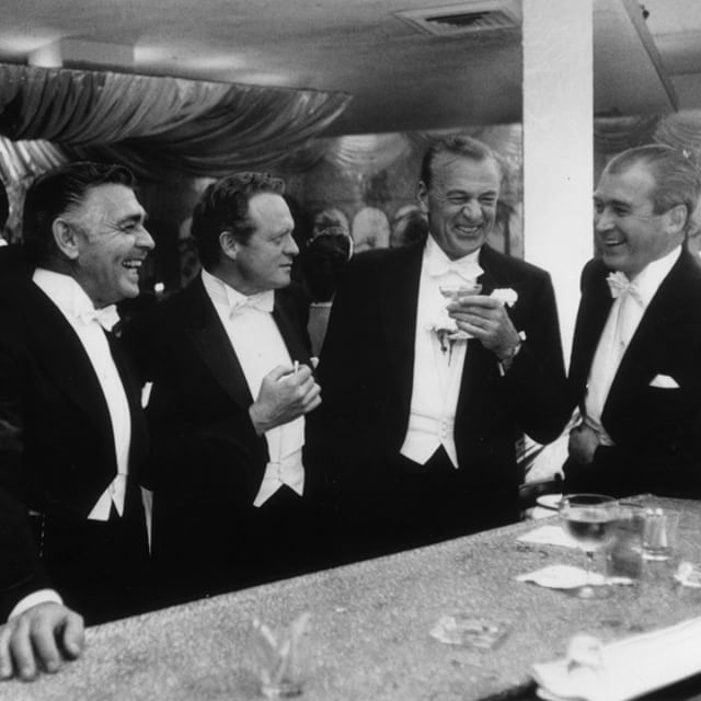 Film stars (L to R) Clark Gable, Van Heflin, Gary Cooper and James Stewart enjoy a joke at a New Year's party held at Romanoff's in Beverly Hills.  Http://cutt.us/Q2MS  #unitedbrothersfruitmarkets @30thAvenueAstoria #Clark Gable #VanHeflin #GaryCooper #Ja