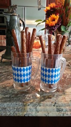 pretzel sticks in beer mugs. oktoberfest.