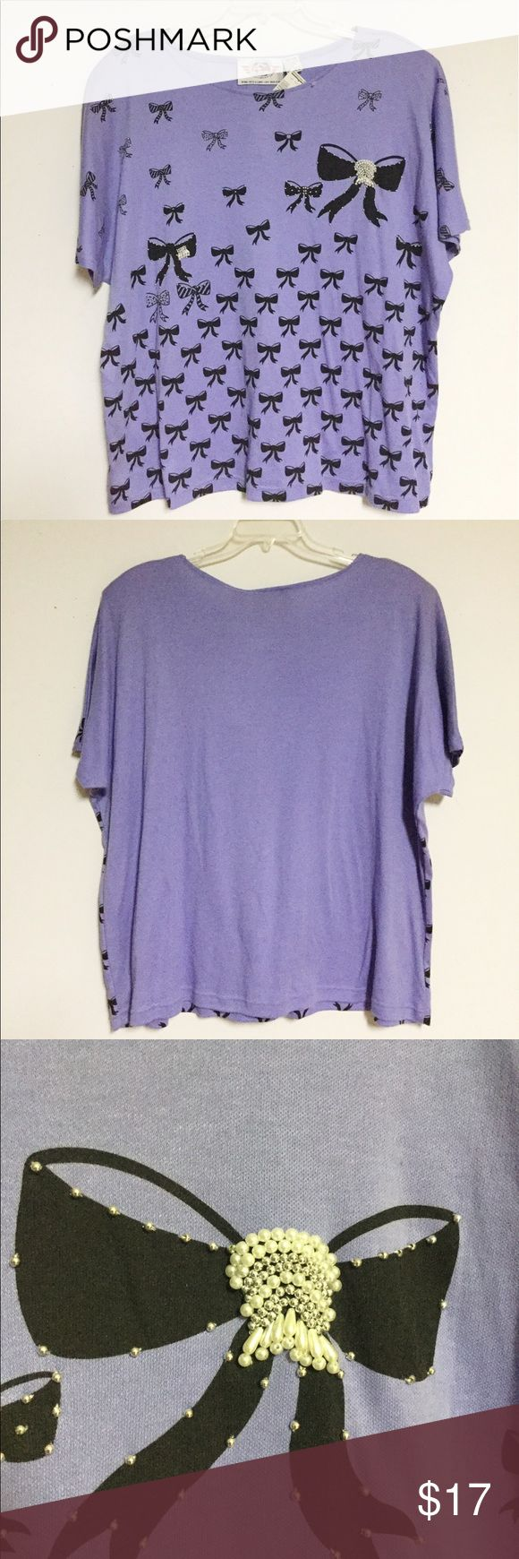 "NWT 24W Vintage Purple Tee w/Bows & Beads Adorable! New with tags. From International Sportswear Co.. Size 24W. Approximate measurements: 28"" long / 56"" bust. 65% polyester / 35% cotton. Hand wash. Shoulder pads. Please note I am pet friendly & I share walls with a smoking household -- thanks!! International Sportswear Tops Tees - Short Sleeve"