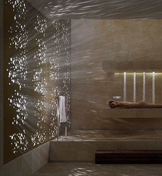 """Flat-Out Fabulous Bring the spa experience of a rain shower home with Dornbracht's first horizontal shower. Six overhead water bars release a pre-programmed symphony of water in varying temperatures and intensities. Just lie down and choose from """"balancing,"""" """"de-stressing"""" and """"energizing"""" effects."""