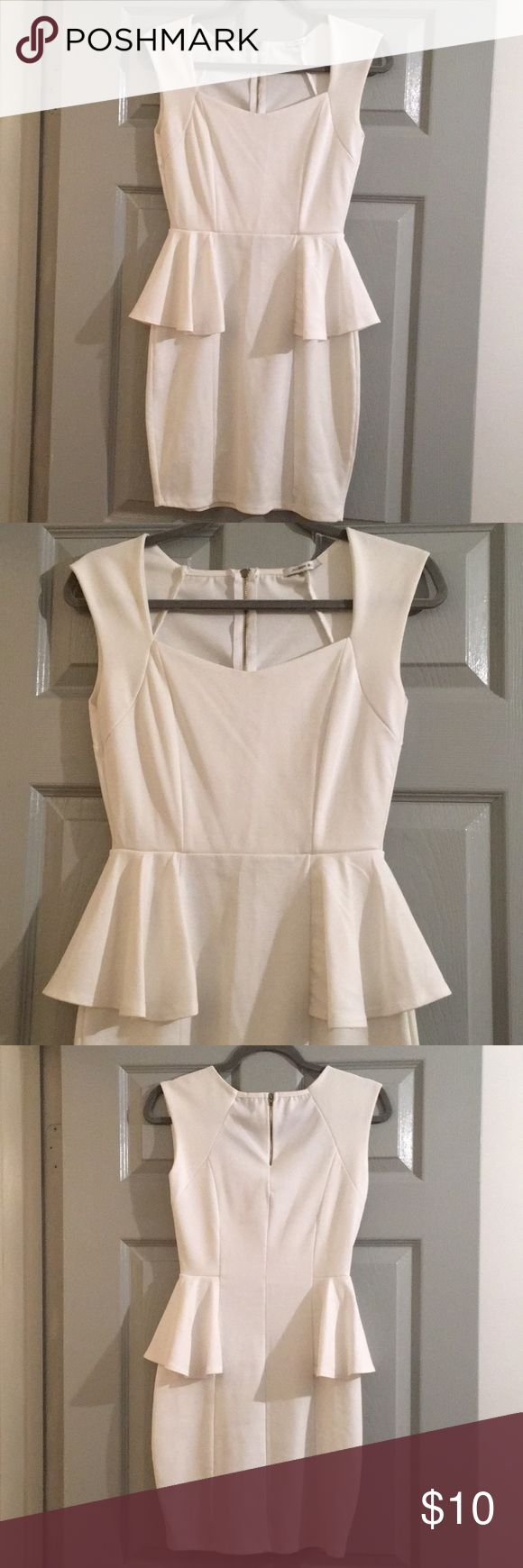 White peplum dress White peplum dress with ruffles at waist, cap sleeve, unique neckline. Gold zipper on back. Worn only once. Would be perfect for a bride-to-be or graduation dress! Dresses