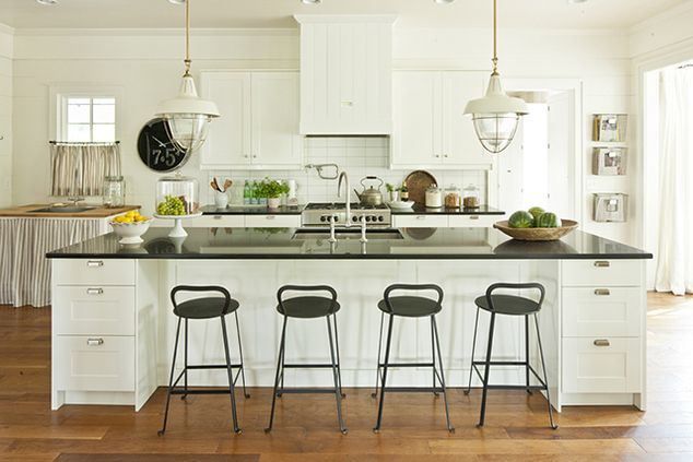 Cottage kitchen with white kitchen cabinets. I'd love to have this much seating at the island. So jealous.