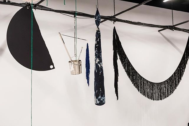 Sterling Ruby's installation within the Calvin Klein look-space. With its buckets and baseball bats, pom-poms, fabric flags and giant, soft-sculpted candles, it is a distinctly personal and peculiar interior monologue that has been made flesh—or rather fabric, metal, and glass—by the artist. #SterlingRuby