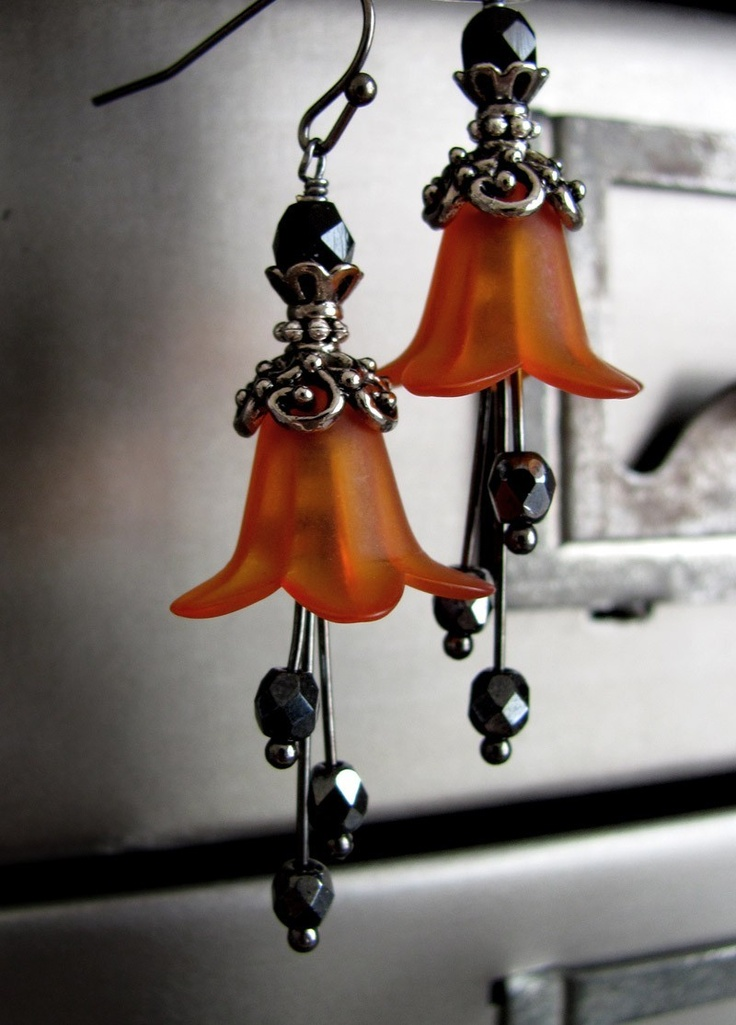 Wicked Orange Halloween Earrings, Pumpkin Orange Flower Earrings with Goth Black and Silver Accents, Vintage Style Halloween Jewelry. $32.00, via Etsy.