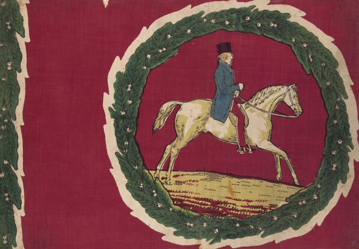 Textile sample of Turkey red dyed and printed cotton with a hand block printed image of a man, possibly the Duke of Wellington, wearing a top hat and riding a horse. This image is surrounded by a laurel wreath decoration. Part of the Turkey Red Collection, A.1962.1266.1 - A.1962.1266.78, with subdivisions, totalling c. 40,000 items: Scottish, Dunbartonshire, possibly by Archibald Orr Ewing and Co., c. 1845