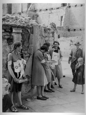 Warsaw, Poland, Girls selling armbands with the Star of David.