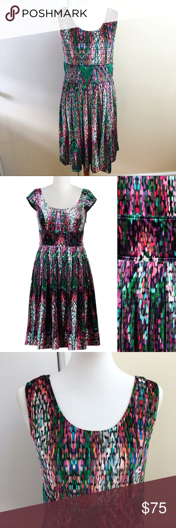"Like New eShakti Stretch Velvet Empire Dress Like new condition with no sign of wear.  Size Large / 14  Stretch velvet with multicolor digital print.  Side zip with pockets.  Skirt fully lined.  Measurements taken flat unstretched:  Bust: 20""  Waist: 17""  Length: 41""  100% Polyester eshakti Dresses Midi"