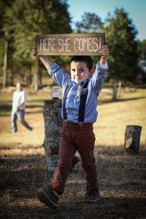 Ring bearer sign!, it would be cute, if it said; Daddy, here she comes!