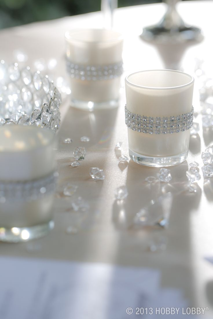 A bunch of candles covered in rhinestones will bring the bling to your wedding!