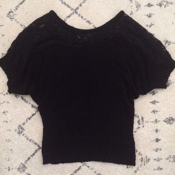 Jennifer Lopez lace chunky Dolman sweater Pretty textured sweater from Kohls. Black with lace shoulders. New condition. This as a bit longer than a typical sweater so it will cover the top half of your bum. Jennifer Lopez Sweaters