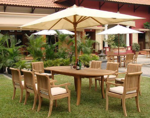 """New 9 Pc Luxurious Grade-A Teak Dining Set - 94"""" Double Extension Oval Table and 8 Arm / Captain Chairs [Model:GVa] by WholesaleTeak. $1829.99. You can lengthen the table with minimal effort by simply opening the butterfly leaf extensions.. Teak wood is an extremely dense course grained hardwood and is widely known for its durability.. Dimension: Armlesss Chair- 20"""" W x 22"""" D x 35"""" H and Arm Chair- 22.5"""" W x 22"""" D x 35"""" H. Table Dimension: 71"""" L (without extension) ..."""