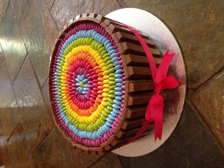 Rainbow circle cake with smarties and kit-kats