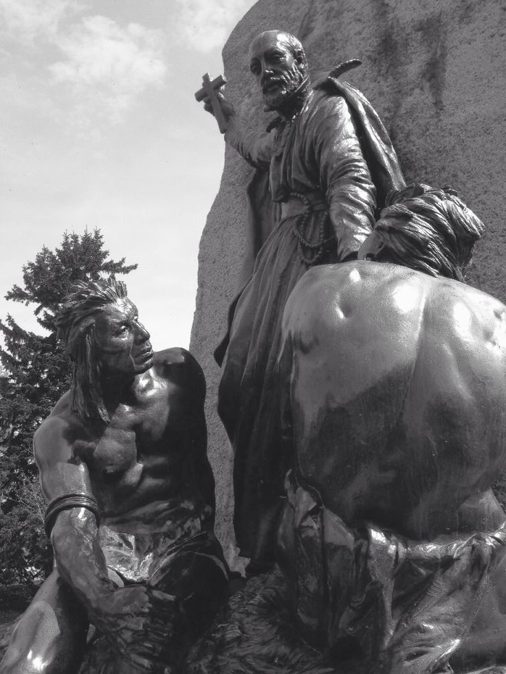 A section of the Champlain statue in Couchiching Park, Orillia.  The first planned European community in Ontario was Sainte-Marie, Jesuits mission in Huronia, erected in 1639 on the Wye River near Midland , 800 miles from Québec. After repeated Iroquois attacks the Jesuits decided to abandon the mission, and it was set afire in 1649. A replica village 'Sainte-Marie Among the Hurons' remains  on the site today along with the Catholic Martyrs Shrine containing some saintly remains.  Photo.L…