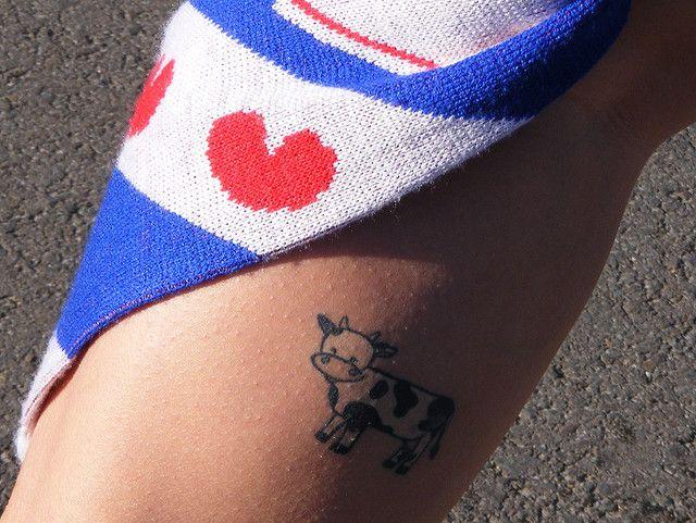My Third Tattoo- It's a cow on my calf! by carolspacelynn, via Flickr