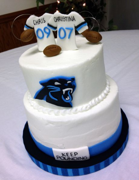 "Carolina Panthers Grooms Cake... however, I don't think I would write ""keep pounding"" on it. Sounds bad. lol"