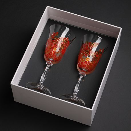 hand-painted and decorated wine glasses in a decorative hand-made box