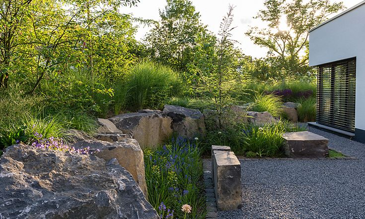 Peter Berg. Garden design using a mix of large size boulders and soft plants such as ornamental grasses and perennials